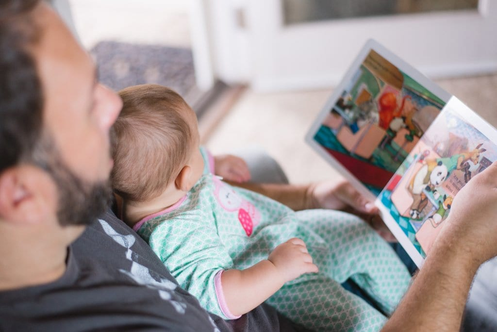 father reading to his child